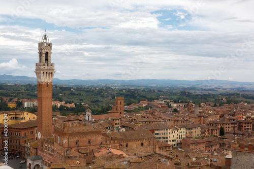 Fototapeta premium Siena,Top view of the Old Town - Piazza del Campo, Palazzo Pubblico di Siena, Torre del Mangia. Tuscany, Italy