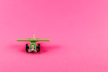 Small Plastic Airplane With Copy Space On Pink Background.