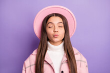 Portrait Of Attractive Amorous Dreamy Girl Wearing Checked Coat Sending Kiss Isolated Over Bright Violet Purple Color Background
