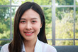 Woman beautiful white skin long hair asian Have a beautiful smile, look healthy. Sit on the sofa in the living room at home. The concept of health care for women in their 30s.