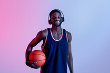 Hapy Black Basketball Player Listening To Music, Wearing Headphones In Neon Lighting