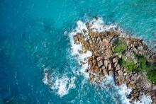 Drone Field Of View Of Waves Crashing Into Rocky Peninsula In Praslin, Seychelles.