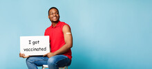 African Guy Holding Poster I Got Vaccinated On Blue Background