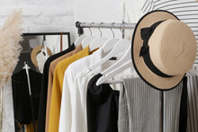 Women's Clothes. Clothes Rack With Stylish Clothes In Fashion Atelier. Summer Wardrobe On A Stand.