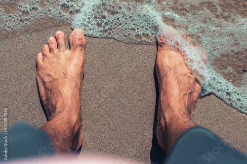 Canvas Print Feet in the sand