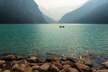 People Doing Kayak In Small Family Group On Lake Louise, Banff National Park, Alberta, Canada.