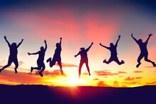 Silhouette Happy Friends Jump On Sunset Sky At Top Of Mountain Abstract Background.