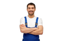 Profession, Construction And Building Concept - Happy Smiling Male Worker Or Builder In Overall Over Grey Background