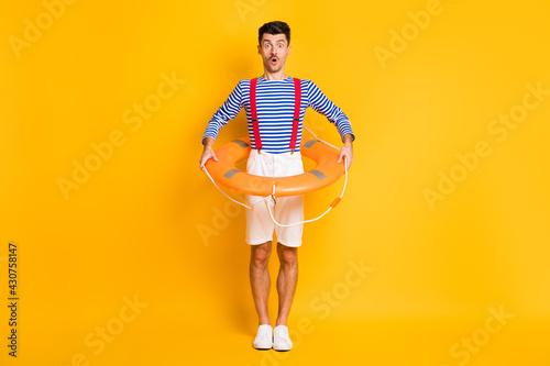 Obraz na plátně Full length photo of amazed brunette man hold lifeguard circle wear summer sailo