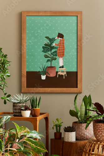 Stylish botany composition of home garden interior with wooden mock up poster frame, filled a lot of beautiful house plants, cacti, succulents in different design pots and floral accessories. Template - fototapety na wymiar