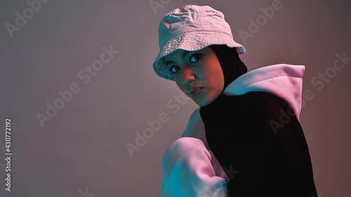 Obraz Fashionable young arabian girl in hijab and panama hat - fototapety do salonu