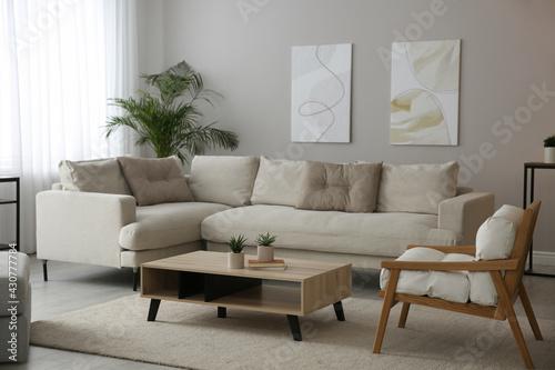 Fototapeta Big comfortable sofa in living room. Interior design obraz