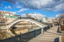 Sadovnichesky Bridge Across The Vodootvodny Canal And A Skyscraper On Kotelnicheskaya Embankment In Moscow