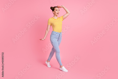 Valokuva Full size photo of optimistic nice brunette lady go look wear t-shirt pants isol
