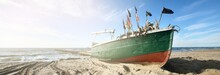 Old Green Fishing Boat Standing On Land In A Small Village, Sandy Shore (sand Dunes) Of The Baltic Sea, Latvia. Vessel, Transportation, Logistics, Industry, Fishing, Farm, Food Production. Rural Scene