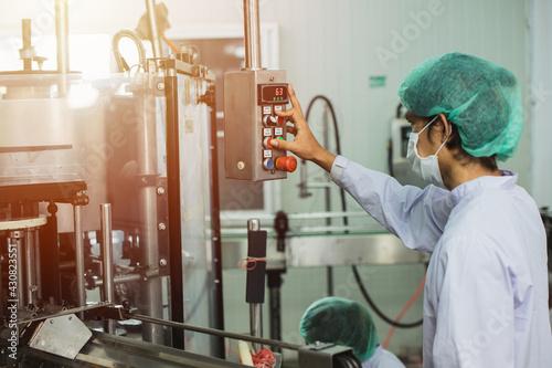 Fototapeta Staff workers working operate control machine in hygiene food factory. obraz