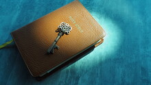 Key And Bible On Grey Marble. Concept Bible Is Key Of Life.  Key  Salvation Is In Bible.  Invaluable Of God's Word. Bible Key Success.  Christianity Background.