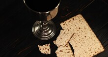 Holy Communion Chalice With Wine And Bread. Super Slow Motion