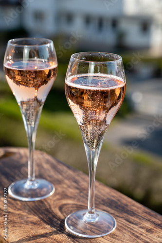 Canvastavla Drinking of rose champagne sparkling wine from flute glasses on outdoor terrace