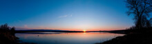 Panorama Of The Evening Lake With A Swan And The Sun, Colorful Shades In The Sky.