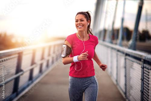 Fototapeta premium Woman running outdoors