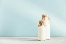 On Dairy Plant Based Milk In Bottles And Ingredients On Blue Background. Alternative Lactose Free Milk Substitute