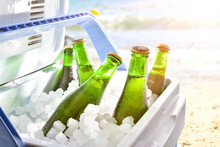Beer Chilled On Ice In Camping Fridge On The Beach
