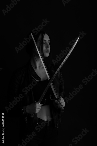 Tableau sur Toile Black and white portrait of a woman with vintage bayonet knife in her hands