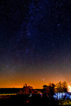 Milky Way And Stars In The Sky Over The Village. Night Astrophotography