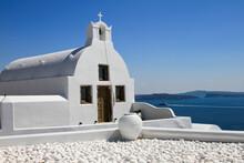 Traditional White Church With Blue Sky And Sea, Oia, Santorini, Greece