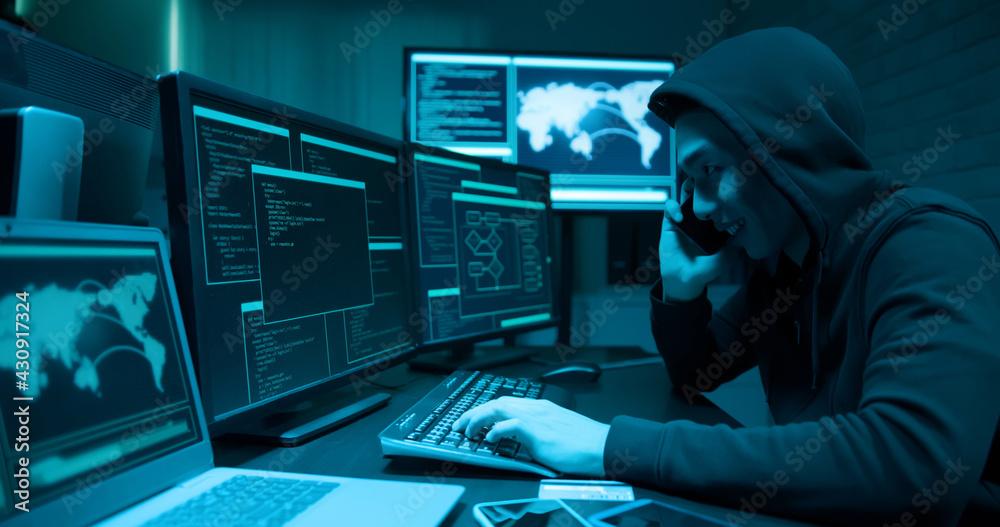 Fototapeta Asian male hacker extorting