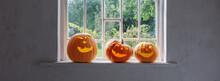 Halloween Pumpkins On White Windowsill