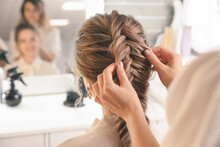 Hairdresser Working With Client In Beauty Salon