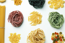 Different Uncooked Color Pasta On White Background