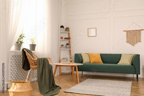 Fototapeta Stylish living room interior with comfortable sofa and small table obraz