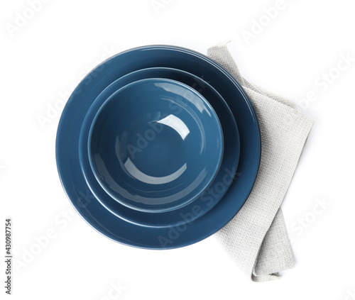 Fotografie, Obraz Stack of ceramic tableware with napkin isolated on white, top view