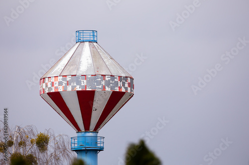Fotografie, Obraz Unusual chimney of a municipal heating plant with a chamber at the top