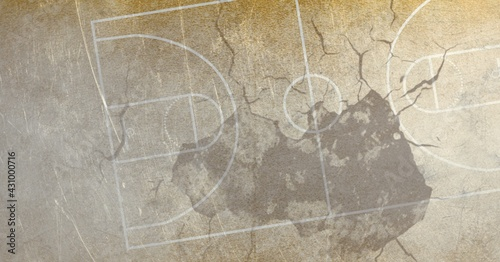 Composition of basketball court over cracked distressed surface