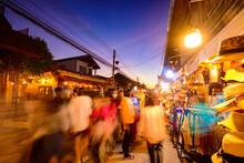Blurred Walking Loei Chiang Khan Walking Street And Night Market,Thailand People In Street Market At Twilight With Bokeh , Chinag Khan , Thailand.