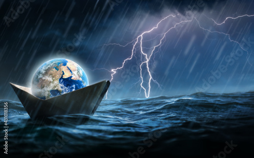 Fotografie, Obraz World in a paper boat floating in the ocean in a middle of a storm