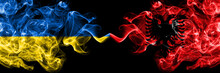 Ukraine, Ukrainian Vs Albania, Albanian Smoky Mystic Flags Placed Side By Side. Thick Colored Silky Abstract Smokes Flags.