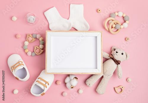 Obraz Mockup of empty frame with eco friendly baby accessories - fototapety do salonu