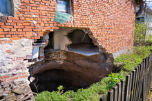 A Sinkhole At The Foot Of The House After The Earthquake