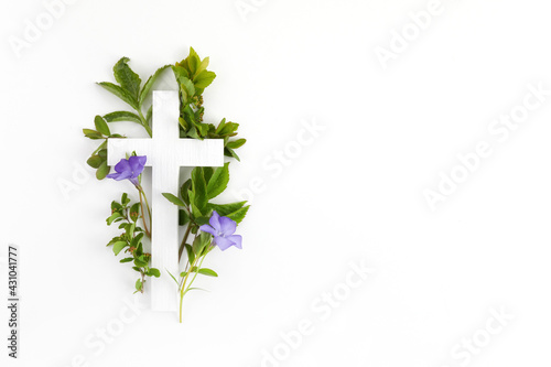Fototapeta The Christianity cross of green leaves. Baptism, Easter, church holiday background obraz
