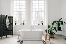 White Freestanding Bathtub In Light Luxury Bathroom