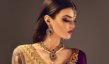 Portrait Of Beautiful Indian Girl. Young India Woman Model With Kundan Jewelry Set. Traditional Indian Costume Lehenga Choli Or Sari