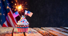 Cupcake Usa Celebration With American Flags And Sparkler
