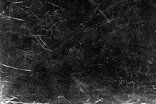 White Scratches And Dust On Black Background. Vintage Scratched Grunge Plastic Broken Screen Texture. Scratched Glass Surface Wallpaper. Dirty Blackboard. Space For Text.