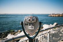 Binoculars Looking At Ocean