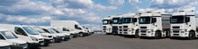 Semi Trucks And Delivery Vans Are Parked In Rows. Commercial Fleet
